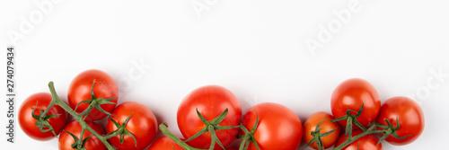 Foto auf Gartenposter Frischgemüse Tomatoes on white background. Healthy food. Long format. Top view. Copy space