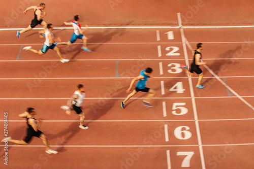 Fototapeta finish line man runners sprinters run 100 meters race athletics obraz