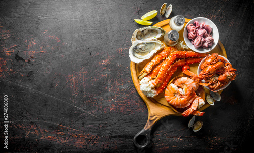 Fresh seafood on a cutting Board with lime and spices. Slika na platnu