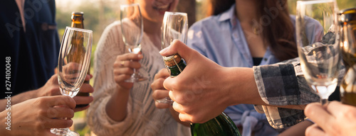 In de dag Alcohol Hands of man in group of friends opening champange for celebrate, cropped dimension for banner