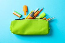 Pencil Case With School Supplies On Blue Background, Space For Text