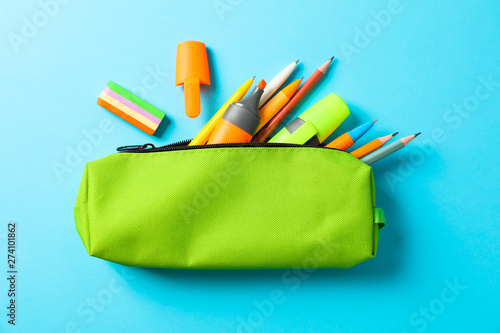 Cuadros en Lienzo Pencil case with school supplies on blue background, space for text