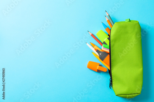 Photo Pencil case with school supplies on blue background, space for text