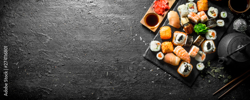 Printed kitchen splashbacks Sushi bar Japanese sushi rolls with salmon, avocado and shrimp.