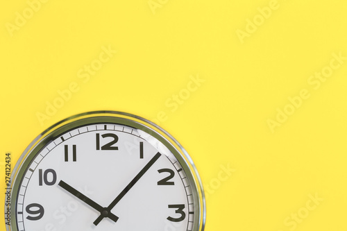 Part of analogue plain wall clock on trendy yellow background Fototapete
