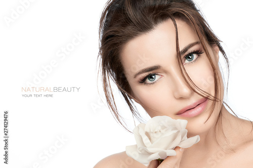 Beautiful young woman with white rose. Skincare and healthy cosmetology concept