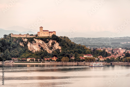 Fotografie, Obraz  Angera castle seen from Arona in a cloudy day