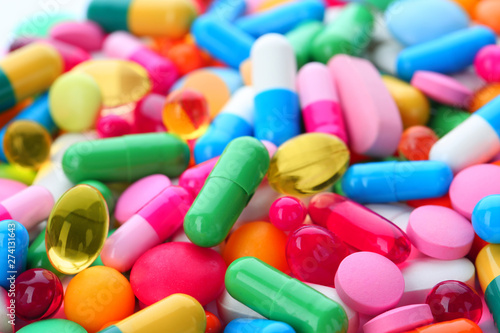 Stampa su Tela  Assorted pills as background, closeup. Medical treatment