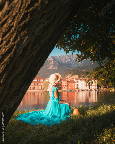 Fototapety, obrazy: A girl posing in front of Pescarenico on the Adda River next to Lake Como and the city of Lecco