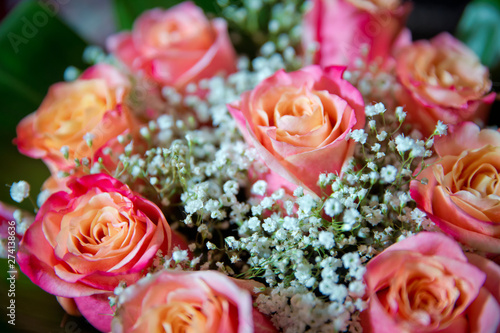 Beautiful bouquet of roses close-up . Pink and yellow mixed Rose, beautiful nature background . Artificial roses on table,Love valentine concept
