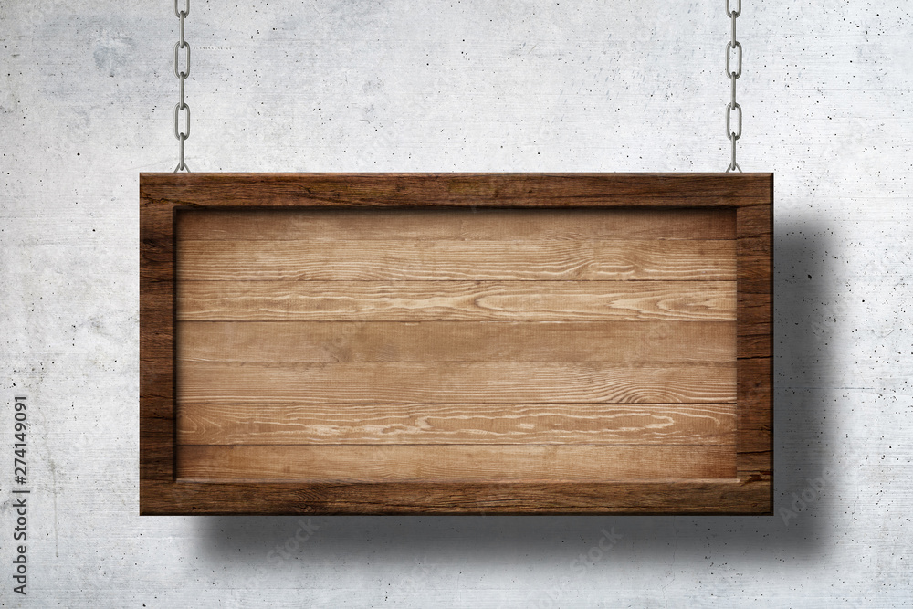 Fototapeta Large wooden sign hanging on chains with concrete wall background