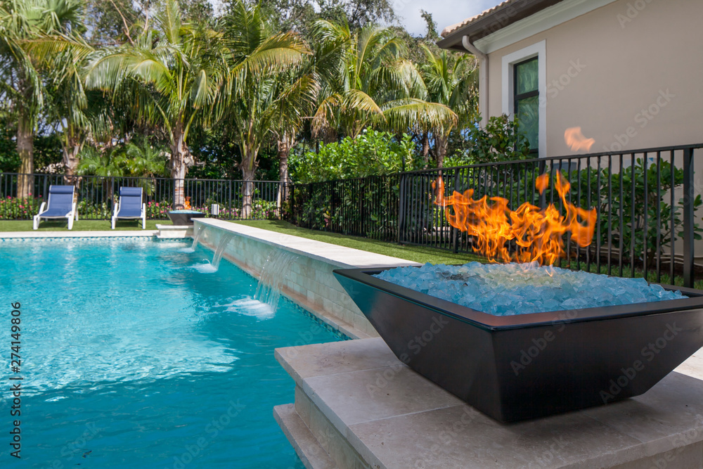 Fototapety, obrazy: Gas fire pit next to a pool with waterfall