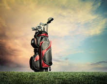 Golf Clubs On Grass Against Dr...
