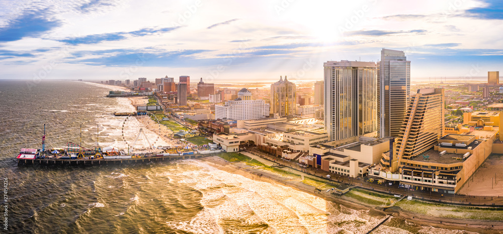 Fototapety, obrazy: Late afternoon aerial panorama of Atlantic city along the boardwalk. Atlantic City achieved nationwide attention as a gambling resort and currently has nine large casinos.
