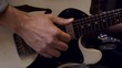 Musician playing guitar close up in 4k