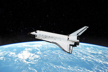Space Shuttle Orbiting In  A S...