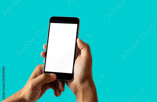Fotografering  Hand holding white mobile phone with blank white screen Dark Turquoise background