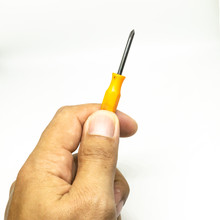 Small Plus Screwdriver On The ...