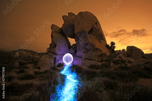 Fotografie, Obraz  Person Light Painted in the Desert Under the Night Sky