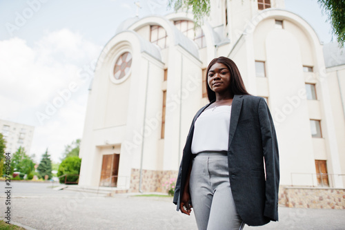 African american woman outdoor against church and prays to