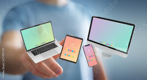 Businessman connecting modern smartphone tablet laptop and computer 3D rendering