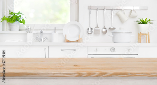 Photo Wood table top on blur kitchen room and window background