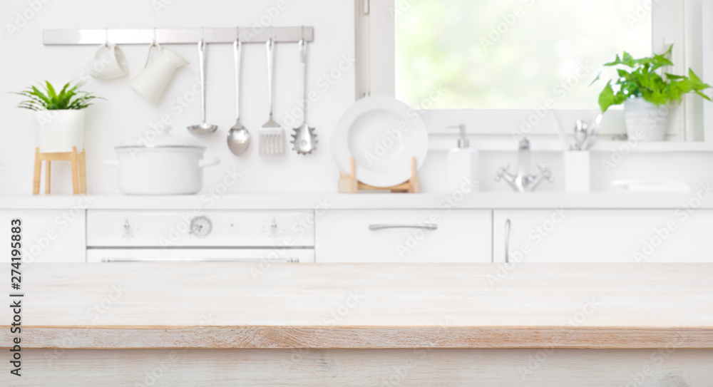 Fototapety, obrazy: Wooden table top on defocused kitchen room and window background