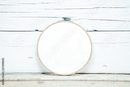Obraz na plátně hoops for embroidery on a wooden background - a round layout for embroidery - ro