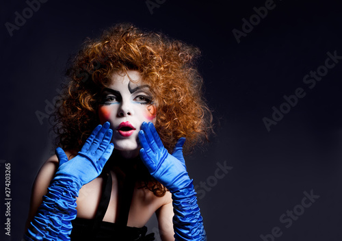 Photo  Woman mime with theatrical makeup. Studio shot.