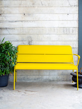 Modern Yellow Bench On Concret...