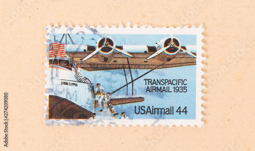 Fotografia  UNITED STATES - CIRCA 1970: A stamp printed in the USA shows Transpacific Airmai