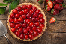 Delicious Strawberry Tart On Wooden Background