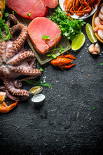 Various Fresh Seafood With Parsley And Lime Slices.