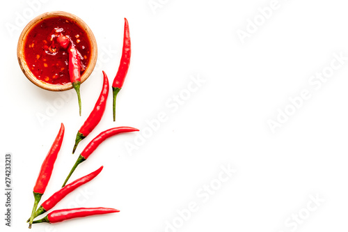 Poster Hot chili Peppers Fresh red chilli pepper as food ingredient on white table background top view mockup