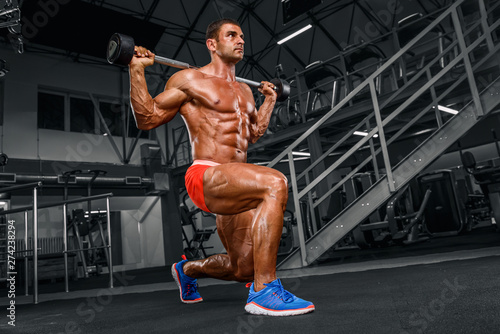 Canvas Print Muscular Men Doing Barbell Lunges at the Gym