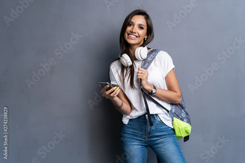 Cuadros en Lienzo Young beautiful woman with smart phone
