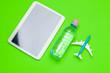 Leinwandbild Motiv Safe travel concept. Clear water bottle and toy plane.