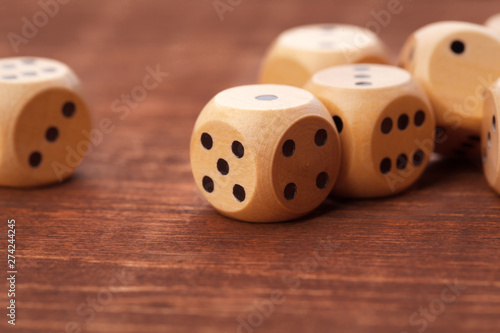 Obraz na plátne  Dice on wooden table. Background for casino games.