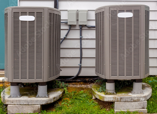 Two freestanding outdoor air conditioning units. Canvas Print
