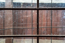 Old Glass Window With Iron Bars And Cobweb - Abstract Background