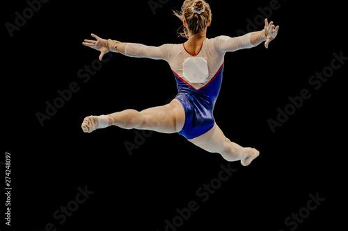 split leap female athlete gymnast gymnastics performance on black background Obraz na płótnie