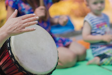 The Girl Plays The Djembe Drum...