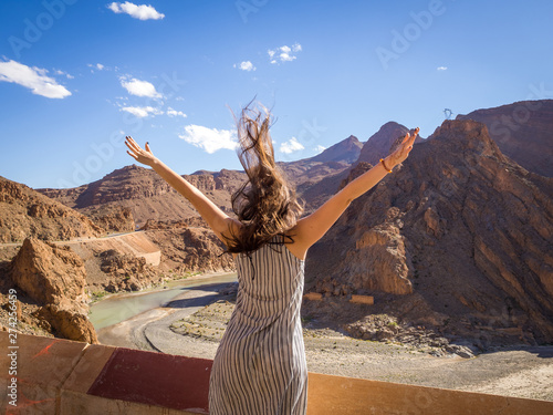 Woman looking ate river bend in the mid atlas mountains of Morocco
