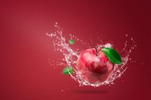 Water Splashing On Fresh Red Apple On Red Background