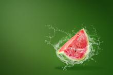 Water Splashing On Sliced Of Watermelon On Green Background