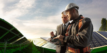 Engineer And Businessman Planing New Ecology Project. They Standing And Looking In Tablet