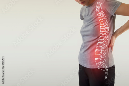 Pain in the spine, a woman with backache