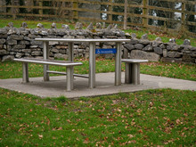 Special Area In A Park With Wheelchair Access. Solid Modern Metal Table And Chair, Concrete Floor Surface.