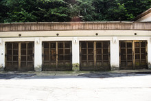 Four Old Garage Doors In The Ancient Grunge Building In The Abandoned City.