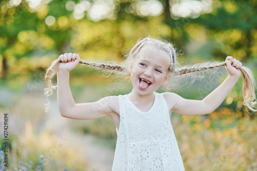 Fotografie, Tablou Funny girl holding hair plaits